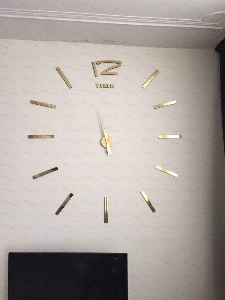 نمونه نصب شده ساعت دیواری فانتزی طرح تایم طلایی