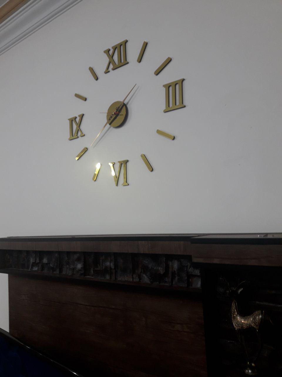ساعت دیواری طرح مدرن رومی طلایی